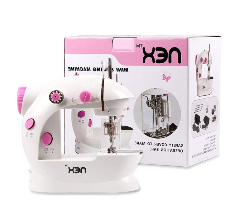 mini sewing machine w safety guard open